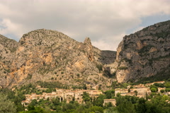 Shadow and clouds passing above Moustiers St. Marie village and monastery 6K Stock Footage