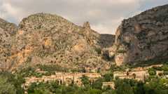 Shadow and clouds passing above Moustiers St. Marie village 4K Stock Footage