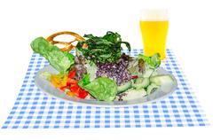 Salad with beer glass and pretzel Stock Photos