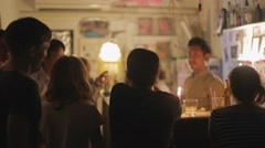 Big group at at intimate local thai bar Stock Footage