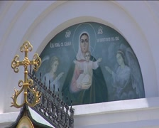 Religious Image of Saints With Halos Golden Cross on the Cathedral Wall Temple Stock Footage