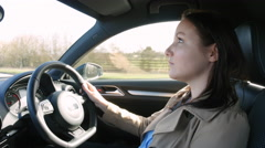 Young woman driving in a car, over shoulder view Stock Footage