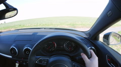 Point of view of driving a car, turning off a rural road Stock Footage