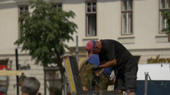 Putting a chain into a box in the Large Square of Sibiu Stock Footage