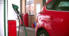 Woman refuelling a car at a petrol station Stock Footage