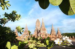 Wat Chaiwatthanaram framed by a frangipani tree, Ayutthaya, Thailand - stock photo