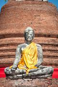Broken Buddha with yellow sash at Wat Worachet Tharam, Ayutthaya, Thailand - stock photo
