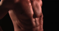 Male bodybuilder flexing muscles, back view Stock Footage
