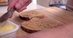 Point Of View Shot Of Buttering Toast Stock Footage