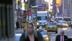 Congested busy street traffic cars people pedestrians Manhattan New York City NY - stock footage