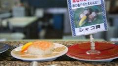 Closeup of sushi on conveyor belt in okinawa Stock Footage