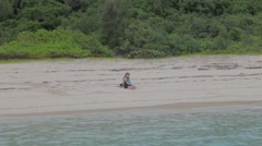 Asian girl deserted on paradise beach - zoom out Stock Footage
