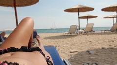 Tropical sunbather beach view Stock Footage