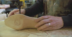 Bespoke Shoemaker Shaping Wooden Last For Shoe Using Jigsaw - stock footage