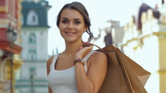 Young beautiful girl with a credit card after shopping Stock Footage