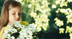 Closeup portrait girl with bouquet of flowers and smiling at camera Stock Footage