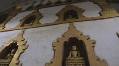 Tilt shot of a wall of buddhas at Ananda temple Stock Footage