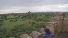 Asian girl looks at the temples from the top of the Shwe San Daw Pagoda Stock Footage
