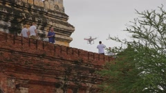A phantom 3 pro drone flying by famous Myanmar Pagoda Stock Footage