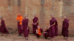 A group of young monks outside Shwe San Daw Pagoda Stock Footage