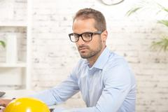 Portrait of a young man in his office Stock Photos
