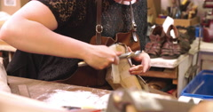 Bespoke Shoemaker Assembling Leather Pieces Together To Make Shoe Stock Footage
