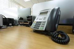 Black telephone on table work of office Stock Photos
