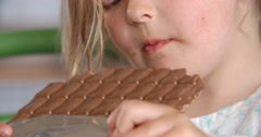 Close Up Of Girl Eating Bar Of Chocolate Stock Footage