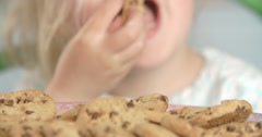 Close up of young girl eating biscuits Stock Footage