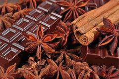 Chocolate, star anise and cinnamon sticks close up as Stock Photos