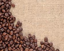 Coffee beans in a sacking background - stock photo
