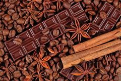 Coffee, chocolate, star anise and cinnamon sticks - stock photo