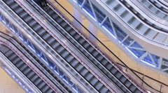 Escalators and shoppers in the mall Aviapark Stock Footage