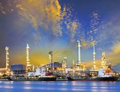 tanker ship and petrochemical oil refinery industry plant with beuatiful ligh - stock photo