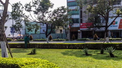 The worker triming the grass in the city of Vietnam. Stock Footage