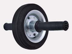 Roller wheel for abdominals on a white Stock Photos