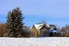 Old farm house in Winter - stock photo