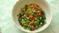 Assorted fresh cut vegetables in a bowl - stock footage