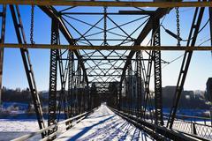 Bridge over the Icy River Stock Photos
