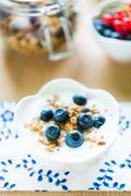 Healthy breakfast with granola, yogurt and fresh fruits - stock photo