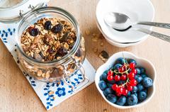 Healthy breakfast with granola and fresh fruits Stock Photos