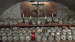 Skulls and crucifix in Charnel House at Hallstatt Austria Stock Footage