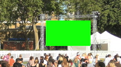 Green Screen Crowd Watching A Big Screen Outdoors Display Stock Footage