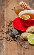 Cup of  tea with ginger,    honey and lemon - stock photo