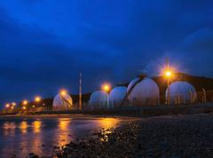 beautiful lighting of gas lpg storage tank in petrochemical industry estate - stock photo