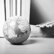 book and earth ball with color pencil black and white color tone style - stock photo