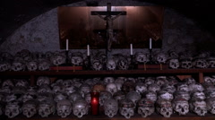Skulls and crucifix memorial Charnel House Hallstatt Stock Footage