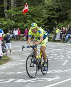 Oleg Thinkov Riding a Bicycle on Le Markstein - Tour de France 2014 - stock photo