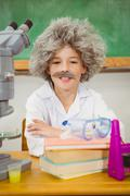 Student dressed up as einstein using a chemistry set Stock Photos