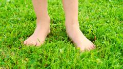 Ten year-old girl standing on the trimmed lawn Stock Photos